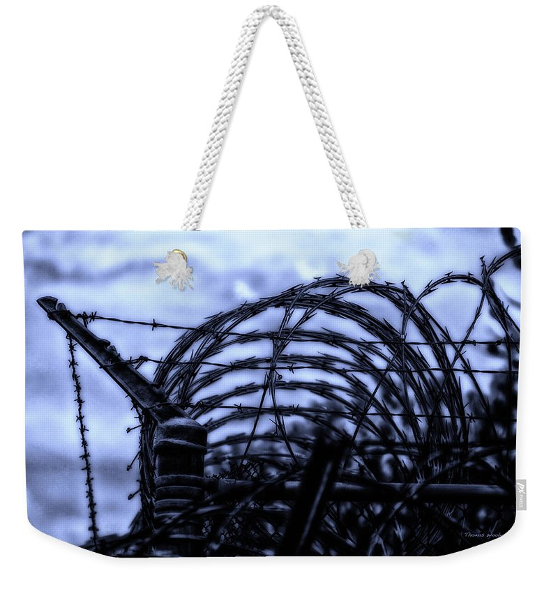 Surrealist Weekender Tote Bag featuring the photograph Midnight In The Prison Yard by Thomas Woolworth