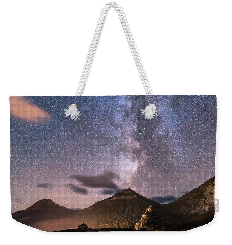 Alberta Weekender Tote Bag featuring the photograph Milky Way Over Prince Of Wales Hotel by Alan Dyer