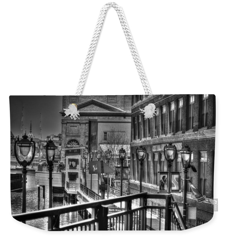 River Walk Weekender Tote Bag featuring the photograph Milwaukee Riverwalk by Deborah Klubertanz
