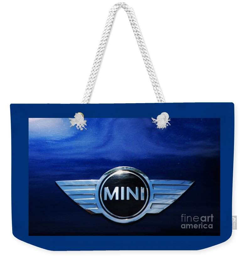Mini Car Logo Deep Blue Shadows Automotive Art Iconic Badge Clouds Reflected Metal Frame Greeting Card For A Mini Owner Canvas Print Poster Pint Available On T Shirts Mugs Tote Bags New Spiral Note Books Throw Pillows Pouches Shower Curtains Weekender Tote Bags And Phone Cases Weekender Tote Bag featuring the photograph Mini Blue by Marcus Dagan