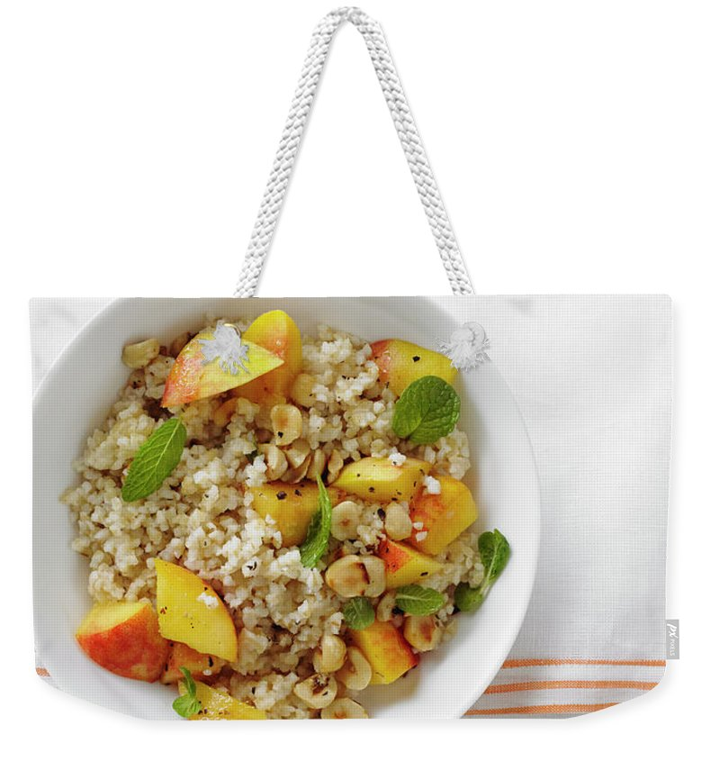 Temptation Weekender Tote Bag featuring the photograph Minted Bulgur And Peach Salad by Iain Bagwell