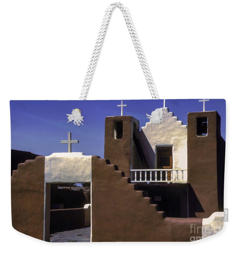Taos Pueblo New Mexico Mission Church Churches Building Buildings Structures Structure City Cities Cityscape Cityscapes Place Places Of Worship Cross Crosses Architecture Weekender Tote Bag featuring the photograph Mission Church by Bob Phillips