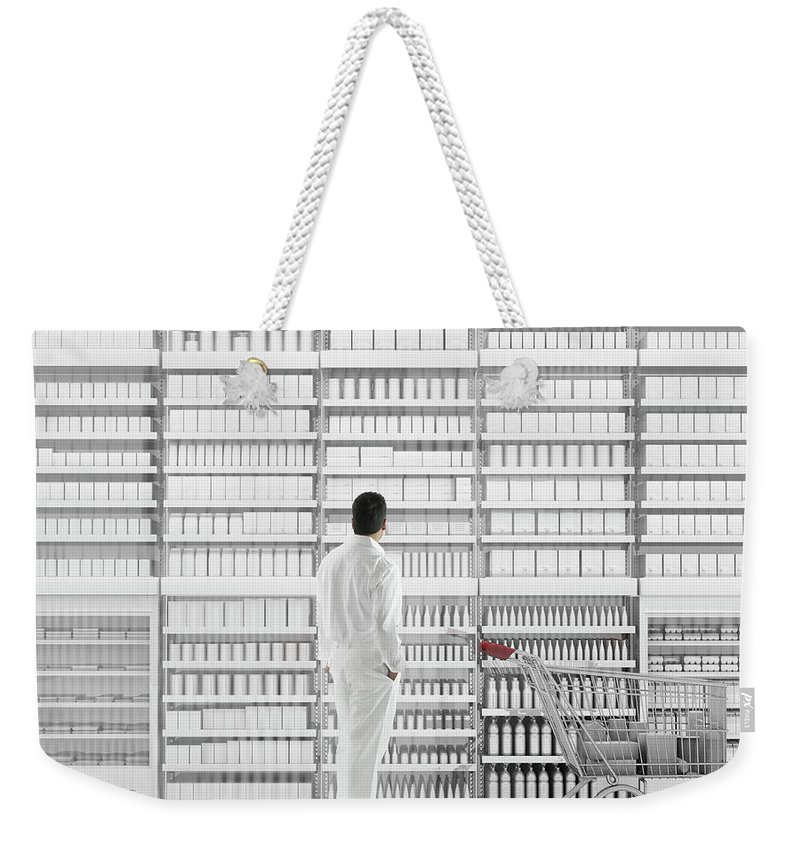 Internet Weekender Tote Bag featuring the photograph Mixed Race Man Shopping On White by Colin Anderson Productions Pty Ltd