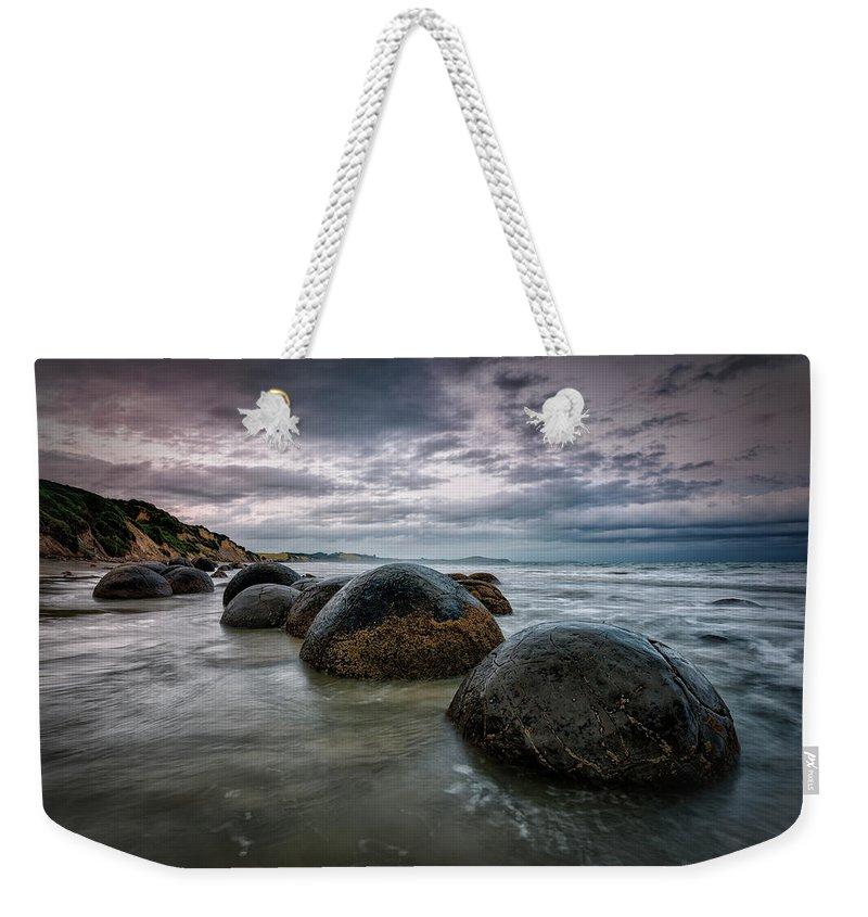 Scenics Weekender Tote Bag featuring the photograph Moeraki Morning | Otago Coast, Nz by Copyright Lorenzo Montezemolo