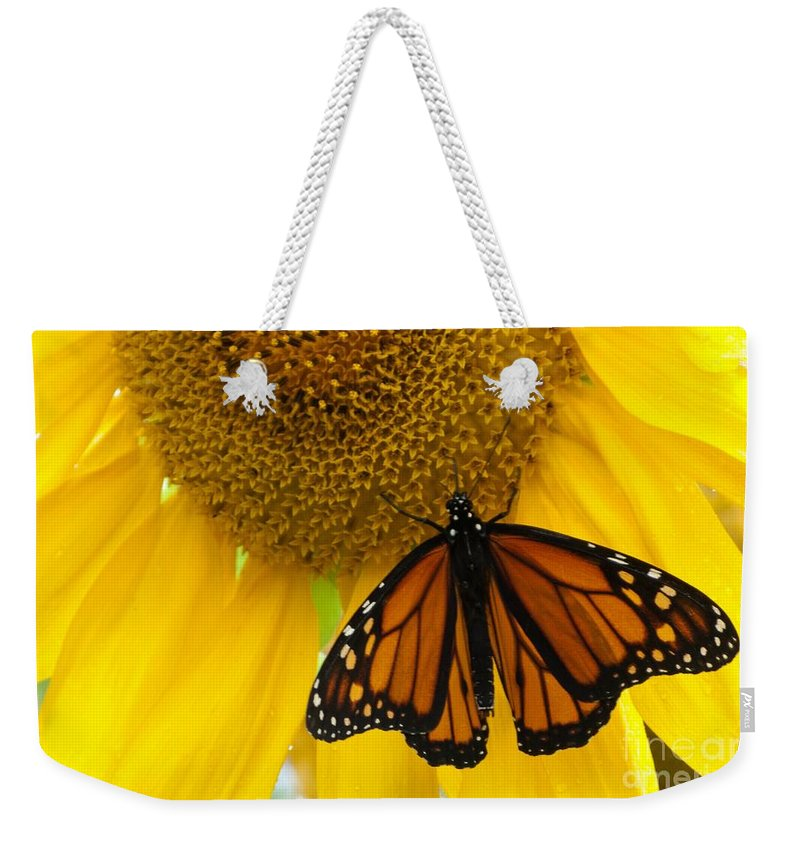 Sunflower Weekender Tote Bag featuring the photograph Monarch And Sunflower by Ann Horn