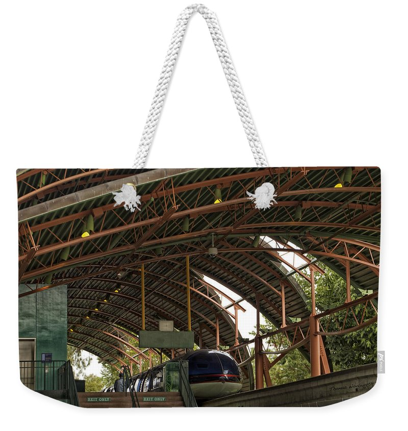 Rail Weekender Tote Bag featuring the photograph Monorail Depot Disneyland 01 by Thomas Woolworth