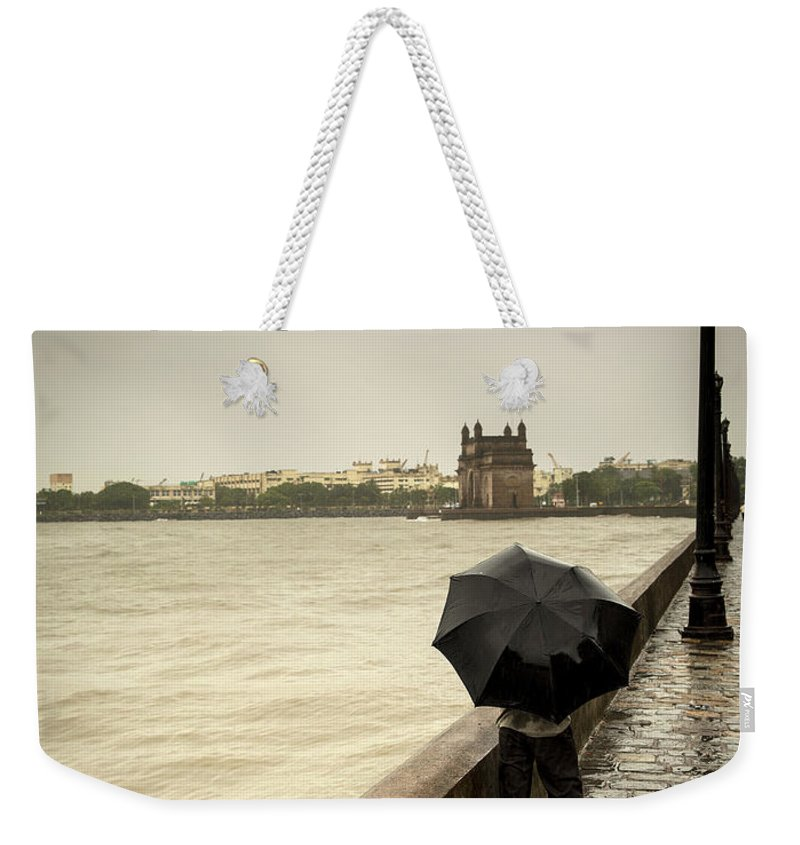 People Weekender Tote Bag featuring the photograph Monsoon In Mumbai by Frank Bunnik