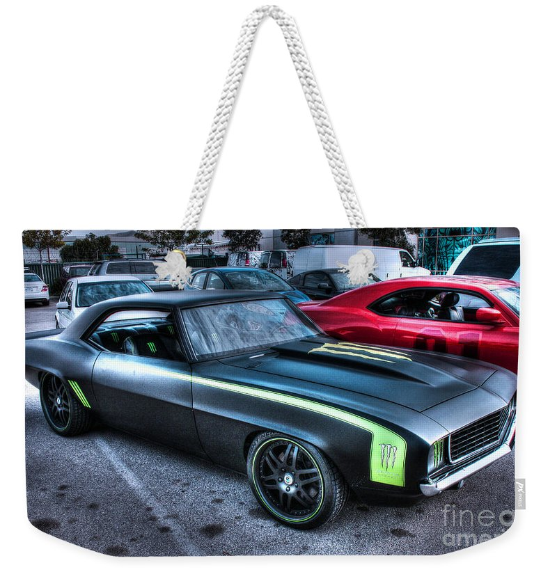 1969 Chevy Camaro Weekender Tote Bag featuring the photograph Monster Camaro by Tommy Anderson
