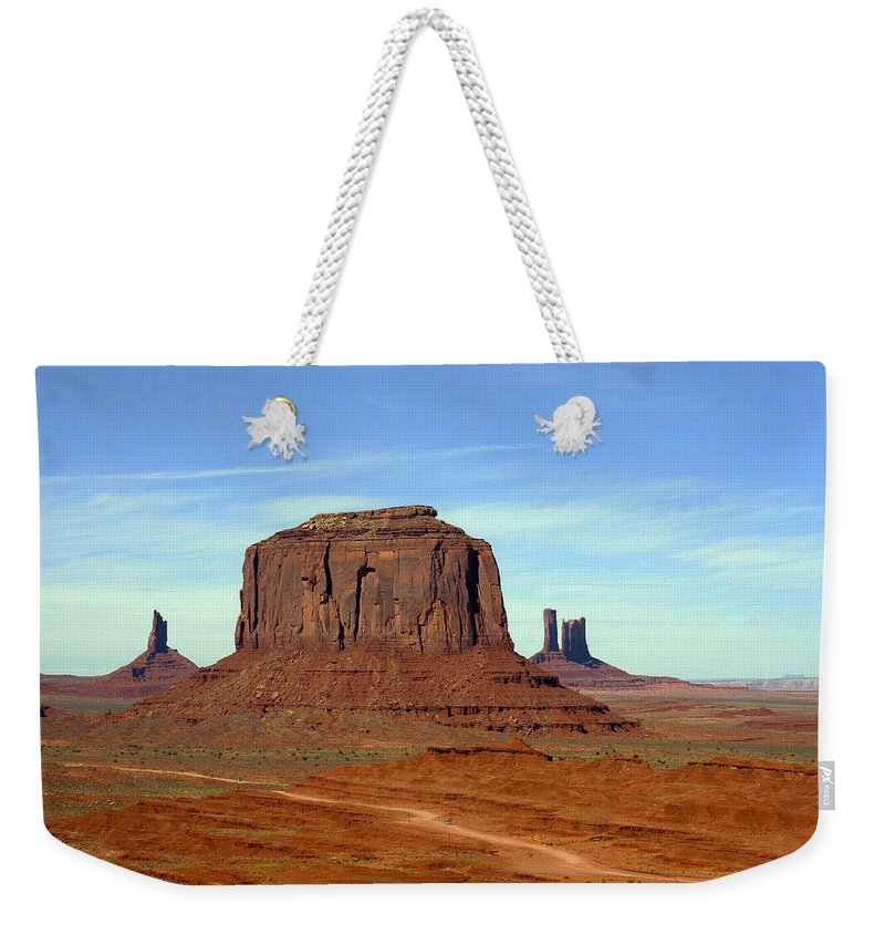 Arizona; Utah: United States; Usa; Southwest; Clouds; America; American; Beauty; Black; Deep; Desert; Environment; Erosion; Formation; Geology; Grand; Weekender Tote Bag featuring the photograph Monument Valley 2 by Ingrid Smith-Johnsen