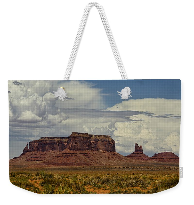 Monument Valley Weekender Tote Bag featuring the photograph Monumental Clouds by Saija Lehtonen