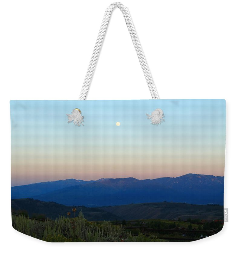 Jackson Hole Weekender Tote Bag featuring the photograph Moon And The Tetons by Catie Canetti