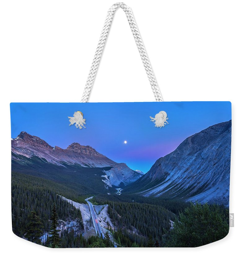 Alan Dyer Weekender Tote Bag featuring the photograph Moon Over Icefields Parkway by Alan Dyer