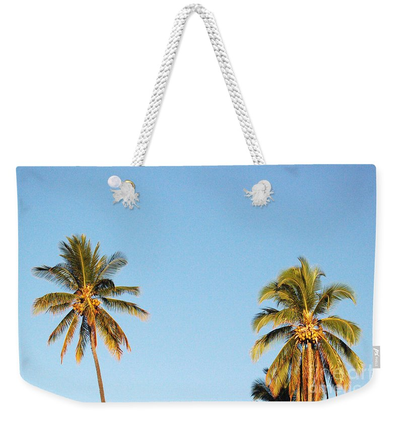 Moon Weekender Tote Bag featuring the photograph Moon Over Molokai by Terry Holliday