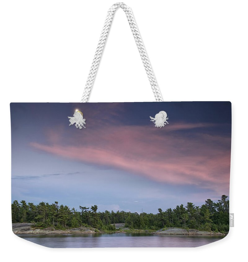 Pointe-au-baril Weekender Tote Bag featuring the photograph Moon Over The Bay by Phill Doherty