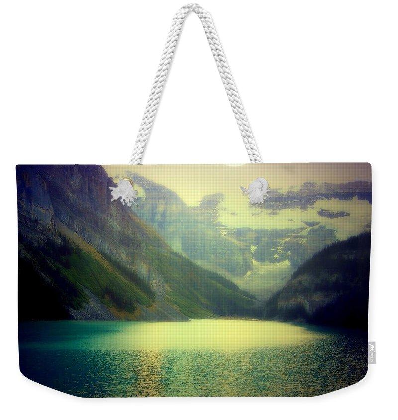 Lake Louise Weekender Tote Bag featuring the photograph Moonlit Encounter by Karen Wiles