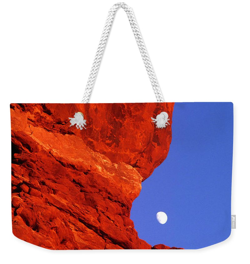 North America Weekender Tote Bag featuring the photograph Moonrise Balanced Rock Arches National Park Utah by Dave Welling