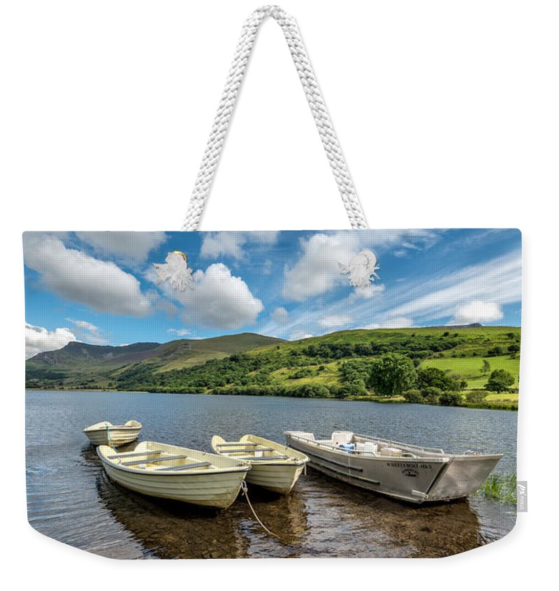 Water Weekender Tote Bag featuring the photograph Moored Boats by Adrian Evans