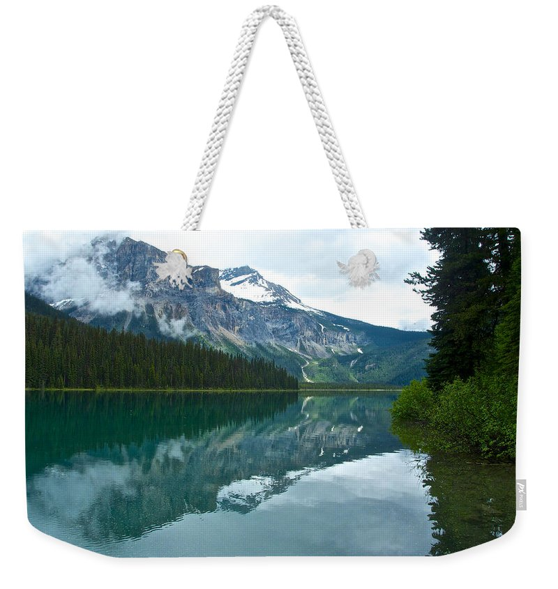Morning Reflection In Emerald Lake From Trail In Yoho Np Weekender Tote Bag featuring the photograph Morning Reflection In Emerald Lake In Yoho National Park-british Columbia-canada by Ruth Hager