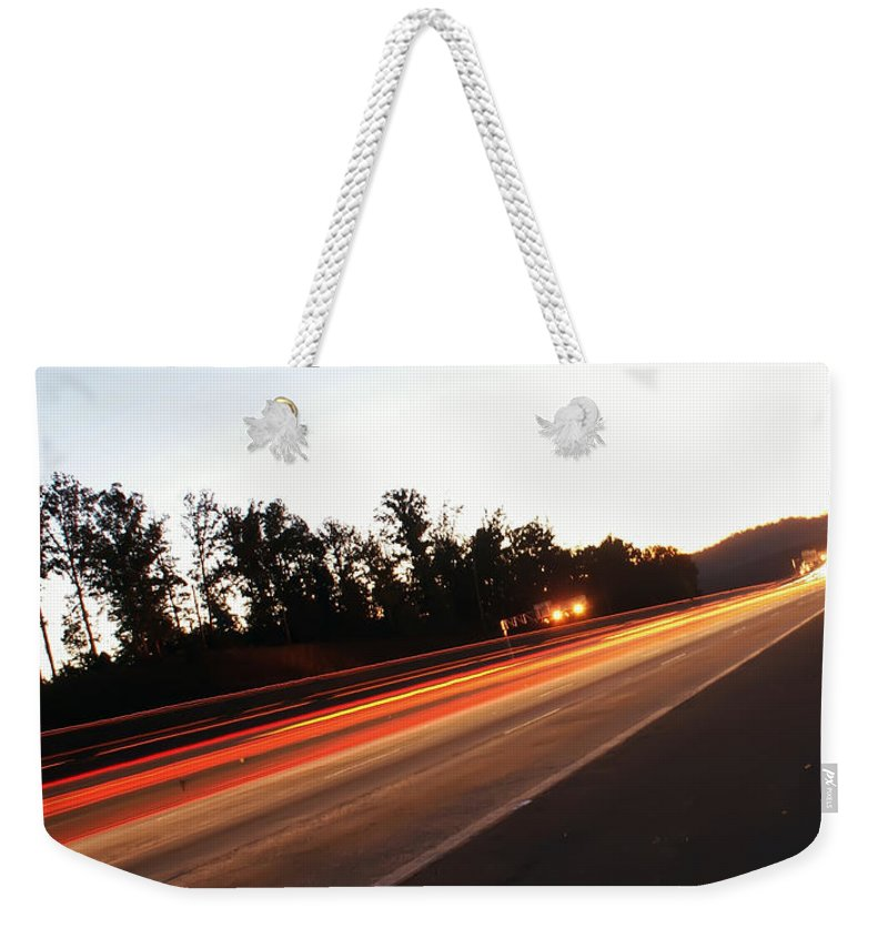 Blurred Weekender Tote Bag featuring the photograph Morning Traffic On Highway by Alex Grichenko