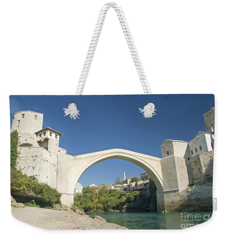 Architecture Weekender Tote Bag featuring the photograph Mostar Bridge In Bosnia by Jacek Malipan