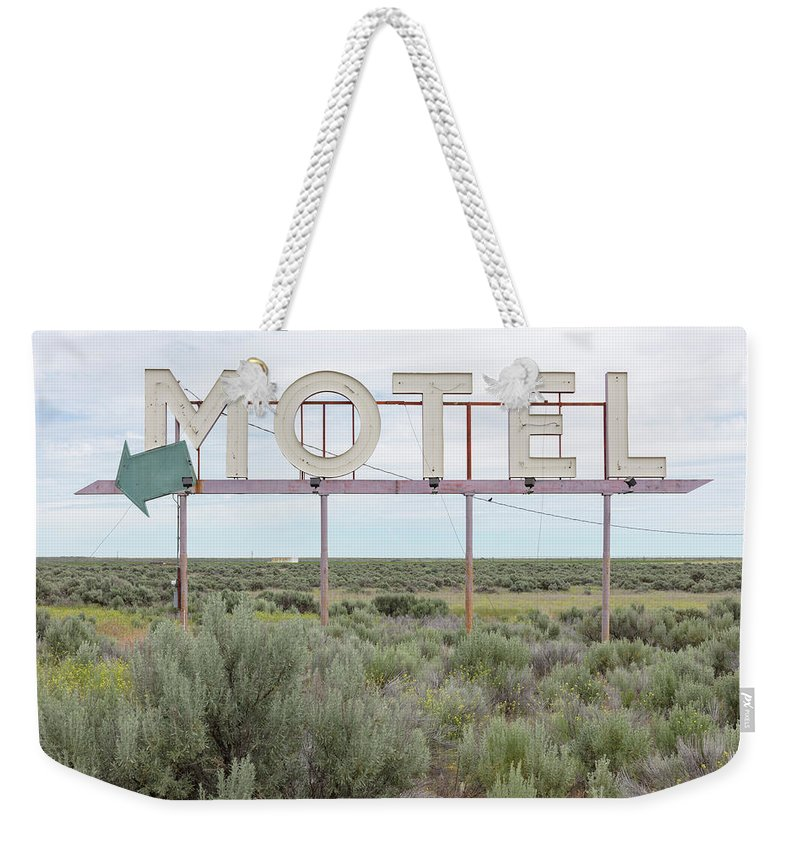 Grass Weekender Tote Bag featuring the photograph Motel Sign In Field Of Sage Brush, Out by Mint Images