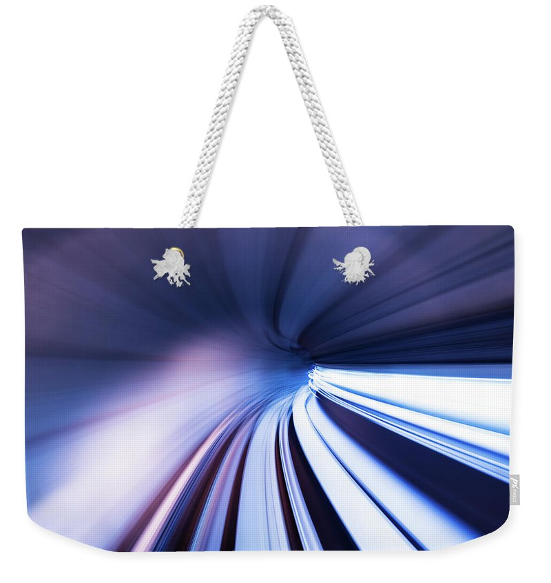 Curve Weekender Tote Bag featuring the photograph Motion Tunnel by Loveguli