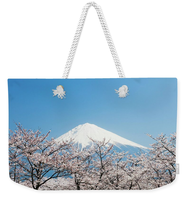 Scenics Weekender Tote Bag featuring the photograph Mount Fuji & Cherry Blossom by Ooyoo