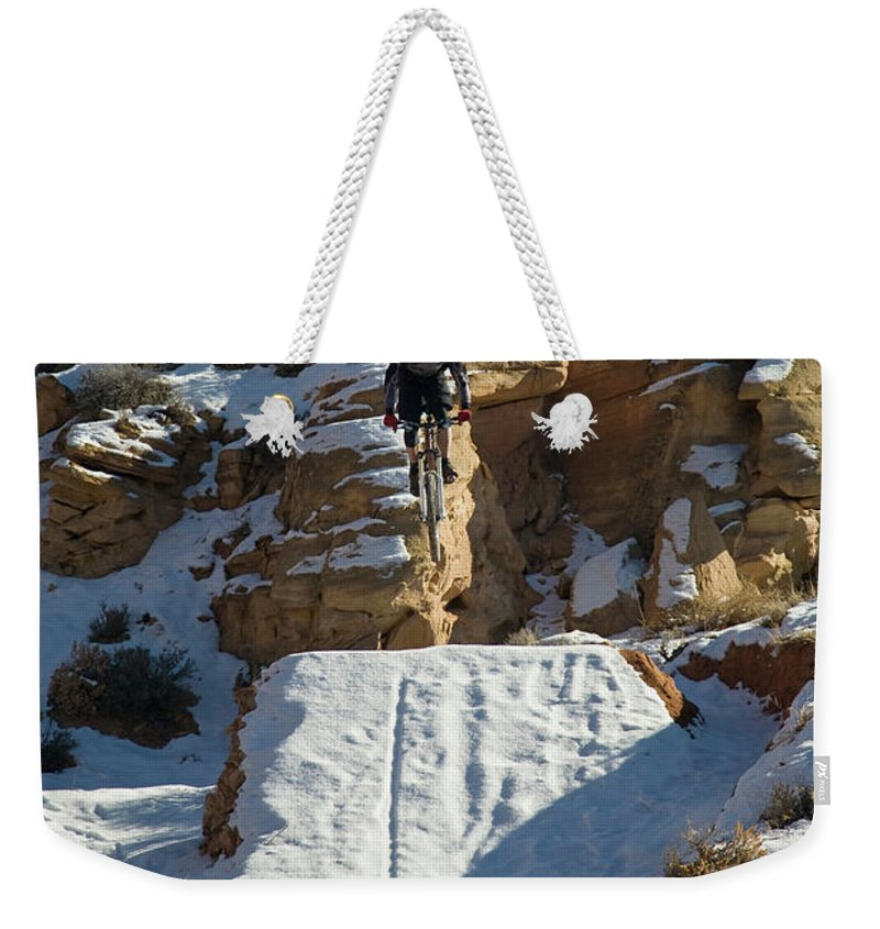 Action Weekender Tote Bag featuring the photograph Mountain Biker Jumping With Snowy by Whit Richardson