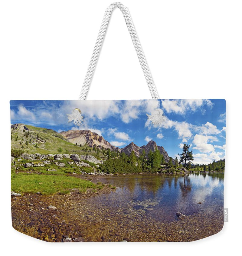 Mountain Lake Weekender Tote Bag featuring the photograph Mountain Lake In The Dolomites by Chevy Fleet