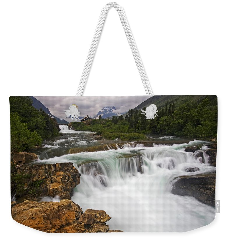 Glacier National Park Weekender Tote Bag featuring the photograph Mountain Paradise by Mark Kiver
