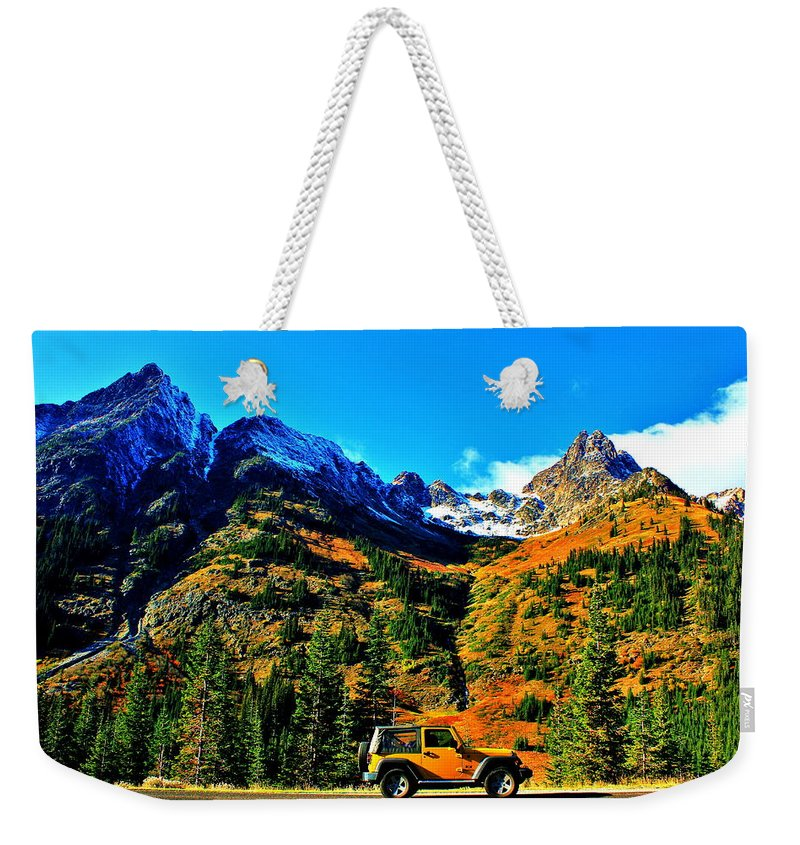 Jeep Weekender Tote Bag featuring the photograph Mountain Wrangler by Benjamin Yeager
