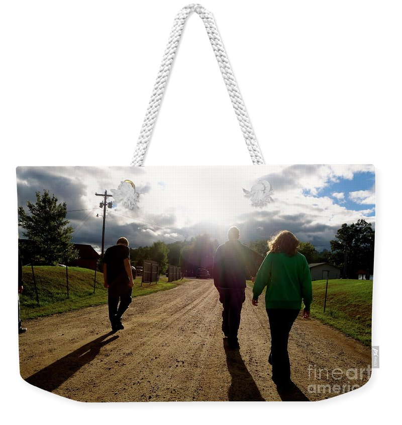 Road Weekender Tote Bag featuring the photograph Moving Forward by Jacqueline Athmann