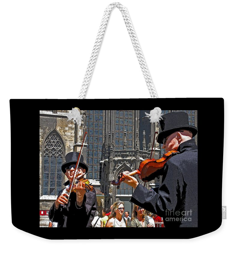 Buskers Weekender Tote Bag featuring the photograph Mozart In Masquerade by Ann Horn