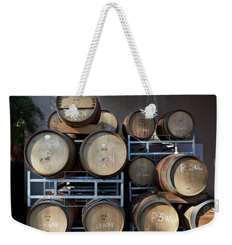 Stellenbosch Weekender Tote Bag featuring the photograph Multible Wooden French Winebarrels On by Klaus Vedfelt
