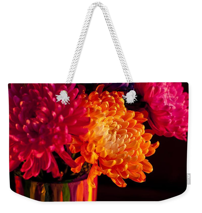 Art Weekender Tote Bag featuring the photograph Multicolored Chrysanthemums In Paint Can On Chest Of Drawers Int by Jim Corwin