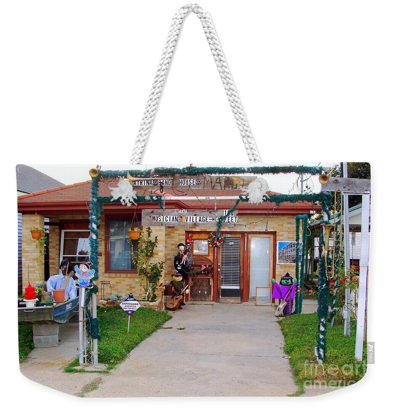 New Orleans Weekender Tote Bag featuring the photograph Musician Village by Ed Weidman