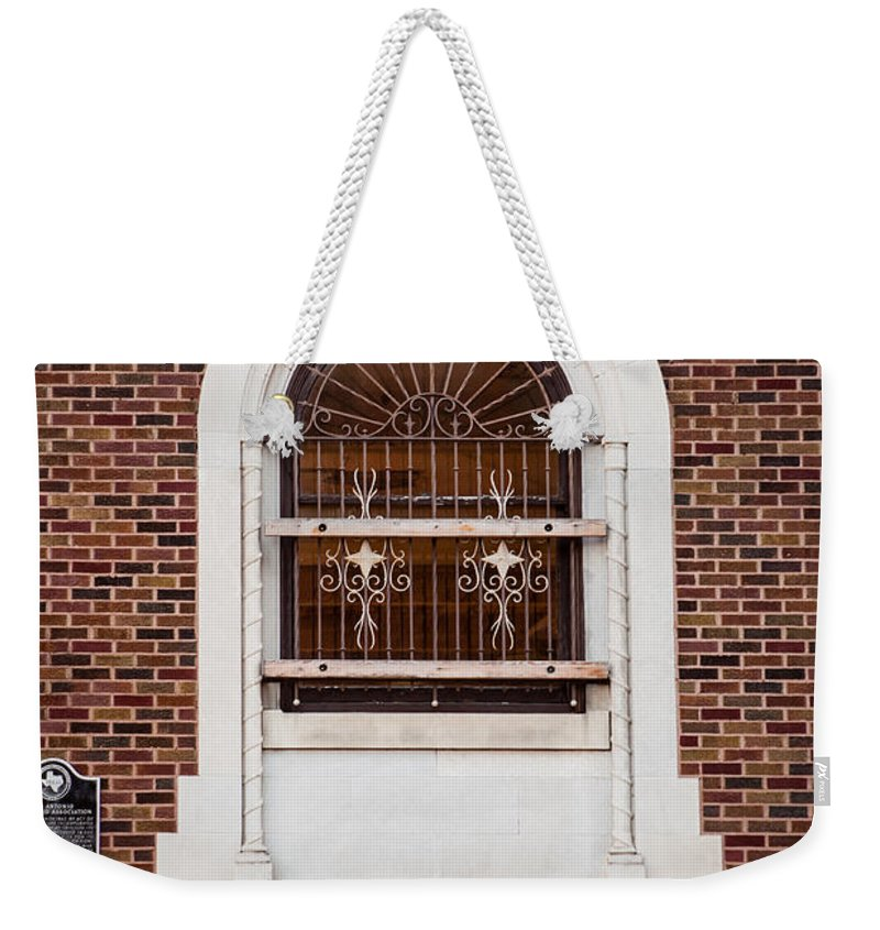 Architecture Weekender Tote Bag featuring the photograph Mutual Aid Historic Bluilding by Melinda Ledsome