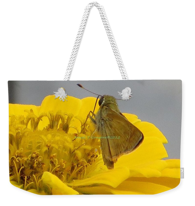 Zinnia The Wonder Weekender Tote Bag featuring the photograph My Favourite Job by Sonali Gangane