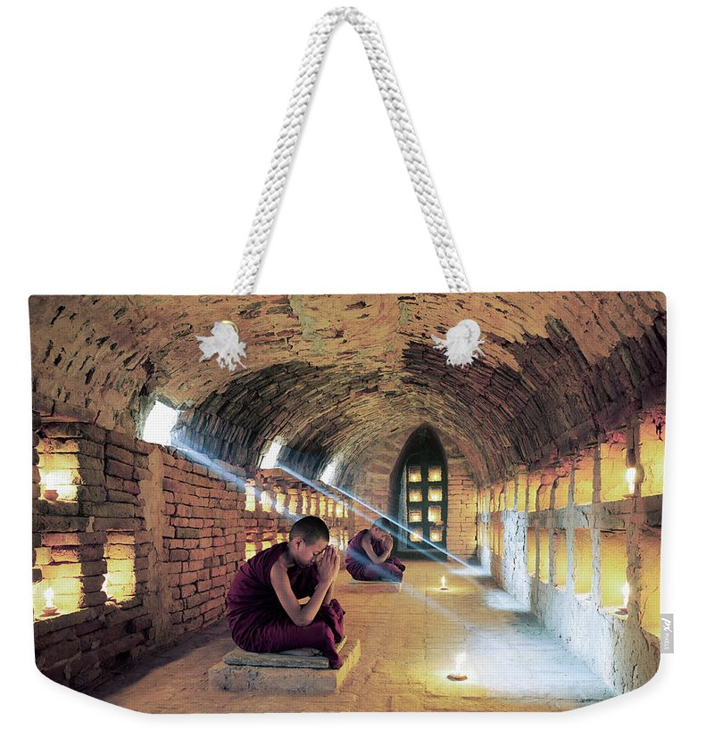 Arch Weekender Tote Bag featuring the photograph Myanmar, Buddhist Monks Inside by Martin Puddy