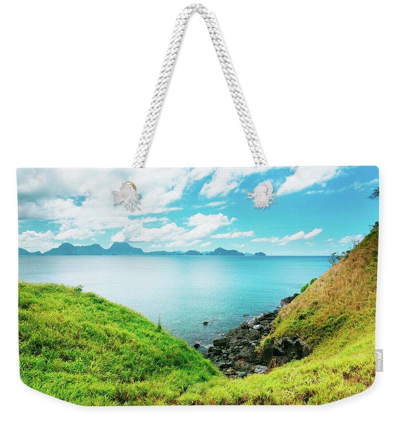 Scenics Weekender Tote Bag featuring the photograph Nacpan Beach Hills by Danilovi