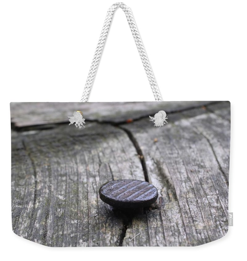 Nail Weekender Tote Bag featuring the photograph Nail And Old Wood by Guna Andersone