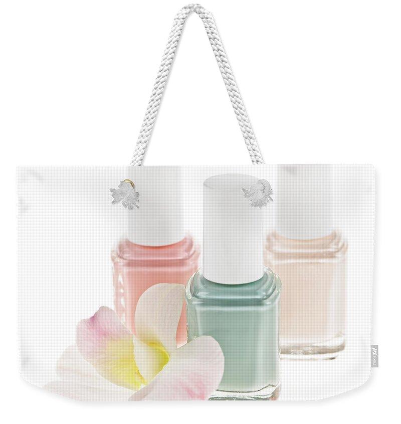 Nail Polish Weekender Tote Bag featuring the photograph Nail Polish Bottles by Elena Elisseeva