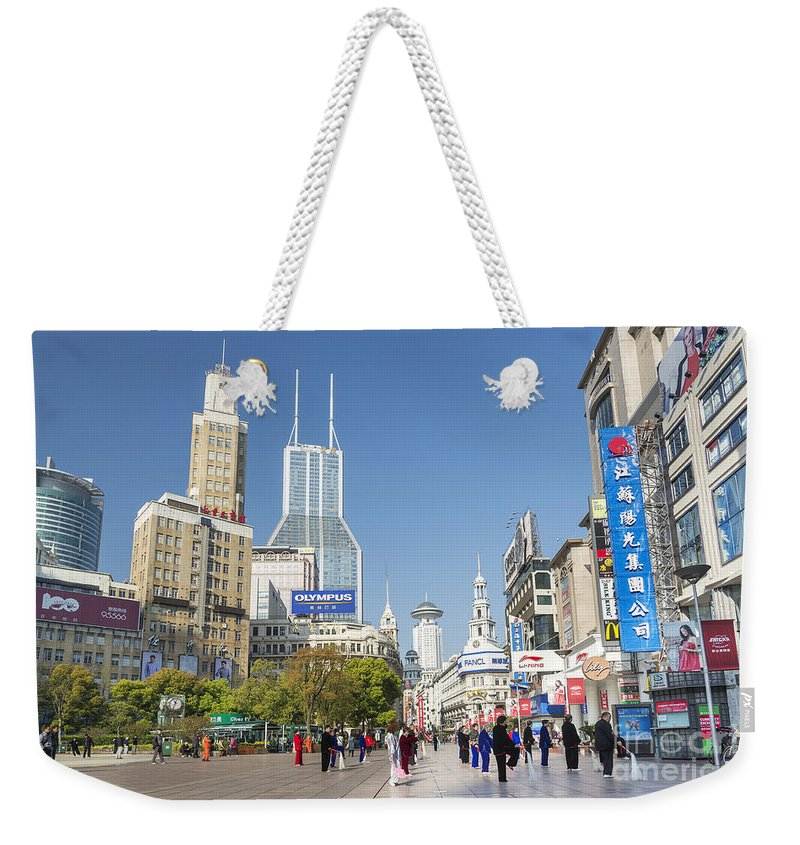 Architecture Weekender Tote Bag featuring the photograph Nanjing Road In Shanghai China by Jacek Malipan
