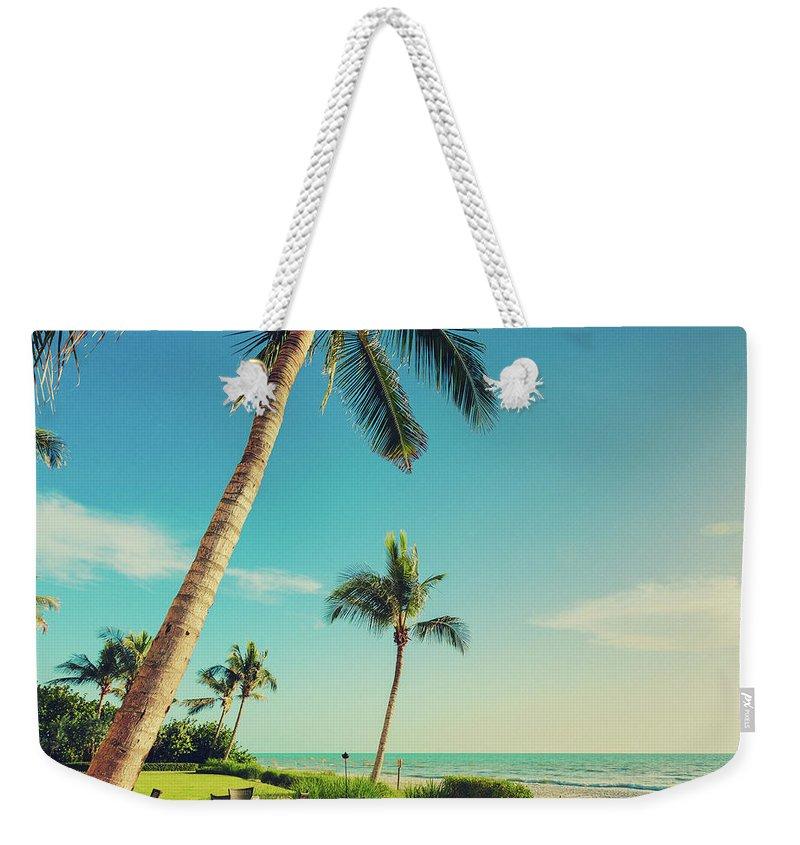 Vacations Weekender Tote Bag featuring the photograph Naple Beach Palms by Thepalmer