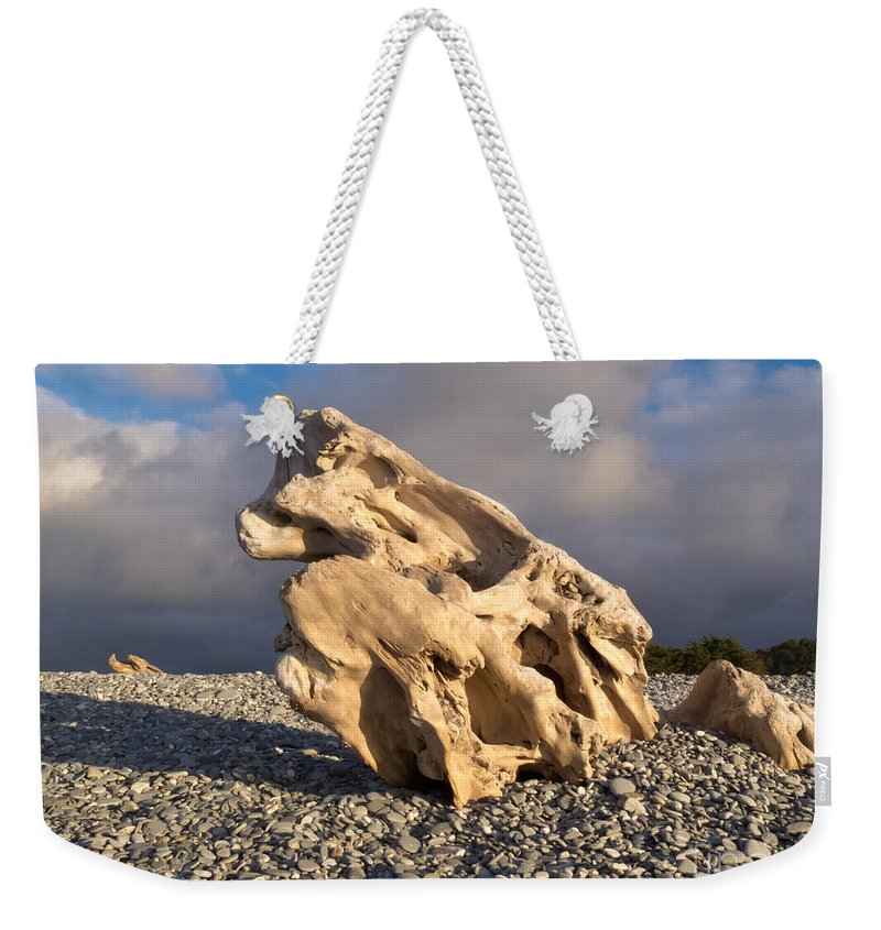 Background Weekender Tote Bag featuring the photograph Naturally Sculpted Waterworn Wood On Pebble Beach by Stephan Pietzko
