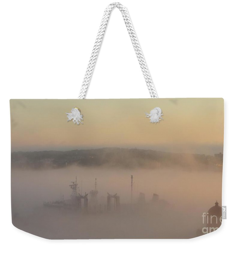 Fog Weekender Tote Bag featuring the photograph Naval Ship Passing Stealthily In The Fog by John Malone