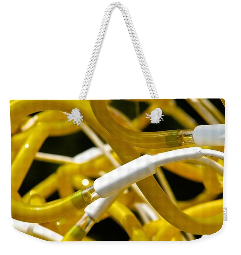 Neon Weekender Tote Bag featuring the photograph Neon by Charlie Brock