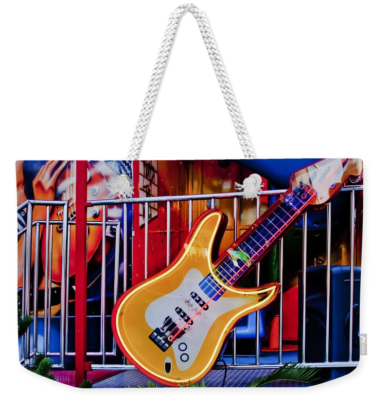 Neon Weekender Tote Bag featuring the photograph Neon Rock N Roll by David and Carol Kelly