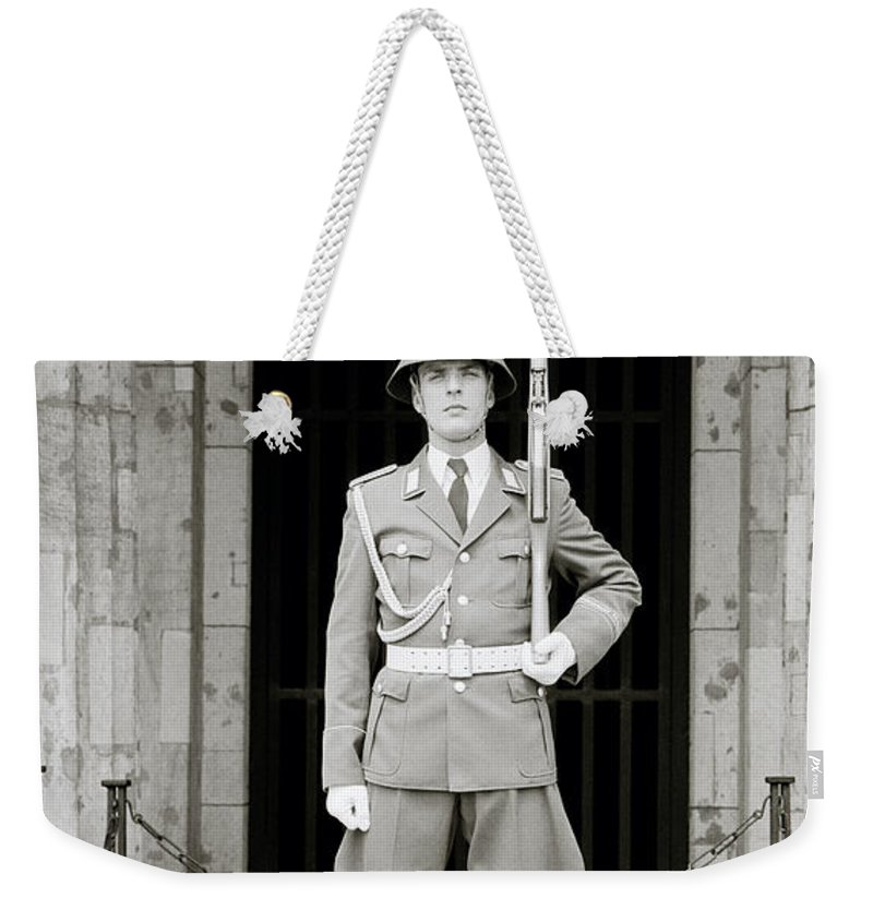 Soldier Weekender Tote Bag featuring the photograph The Soldier by Shaun Higson
