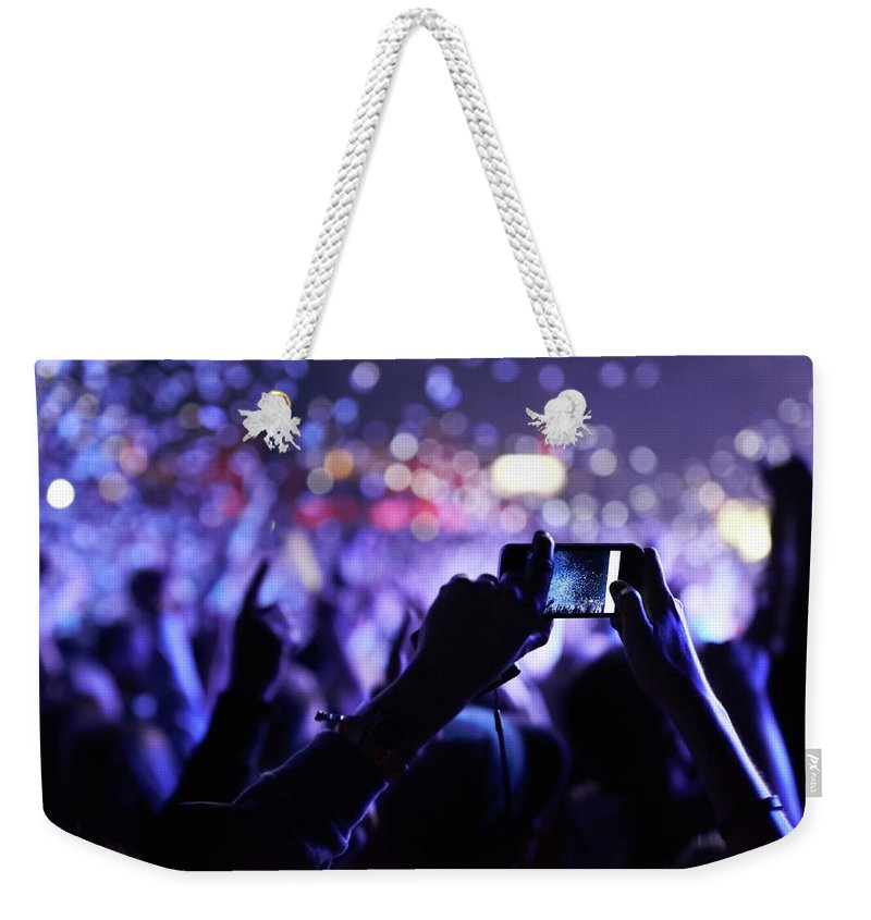 Event Weekender Tote Bag featuring the photograph Never Forget This Moment by Peopleimages